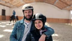 Portrait of happy couple with helmet on the riding lesson at the stable HD Stock Footage