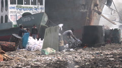 Garbage dump on the shores of the Buriganga river in Dhaka, Bangladesh Stock Footage