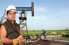 oil workers on oilfield - stock photo