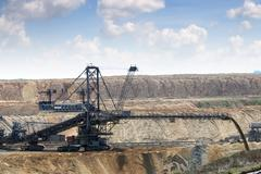 Open pit coal mine with giant excavator Stock Photos