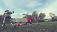 Dad and son playing football. Filmed with slider Stock Footage
