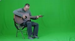 Green screen of a male playing the guitar Stock Footage