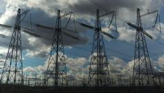 Power transmission line with cloudy sky on the background - stock footage