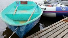 Oars, empty boat on a pier - stock footage