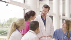 4K Diverse medical team having a group discussion in modern hospital Stock Footage
