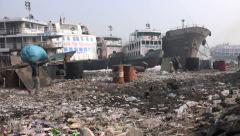 Garbage dump along the river in Dhaka, Bangladesh Stock Footage