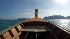 POV on a traditional long-tail wooden Thai boat on ocean 1 Limestone islands 4k Stock Footage