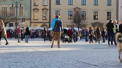 Main market square with tourists in Krakow, Poland Stock Footage