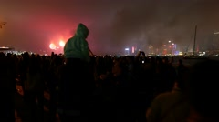 Crowd watching firework, panning overhead shoot viewer silhouettes in darkness Stock Footage