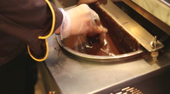 Chocolatier prepare strawberries in chocolate Stock Footage