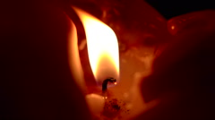 Candle flickering flame slow motion Stock Footage