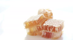 HD footage of honeycombs on white background Stock Footage