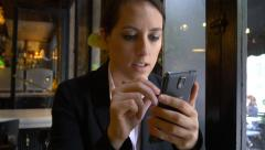 Attractive businesswoman using mobile phone cafe shop smartphone pen city 4k Stock Footage
