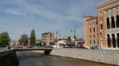 City Hall Sarajevo and the Miljacka River in Bosnia and Herzegovina Stock Footage
