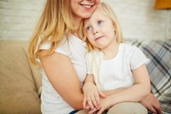 Girl with mommy - stock photo