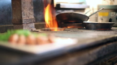 Tuna steak seasoned with sauce and salt on a wood burning stove, closeup Stock Footage