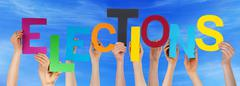 Hands Holding Colorful Word Elections Blue Sky - stock photo