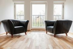 Stock Photo of Leather black armchairs in a room