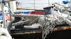 Swinging mooring line of a trawler Stock Footage