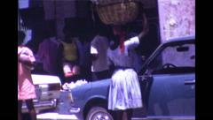 Woman holding Basket on Head in Port Au Prince, Haiti 1973 Super 8 Stock Footage