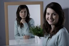 Woman with bipolar personality disorder - stock photo