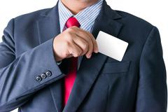 Part of body of business man who takes out business card from the pocket - stock photo