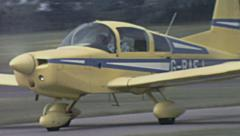 England 1970s: Piper aircraft parking after landing Stock Footage