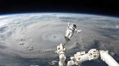 Astronaut in space earth and hurricane in background Stock Footage