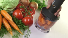 Using stick hand blender with chopper attachment for chopping row carrot Stock Footage