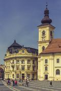 The Great Square and Roman-Catholic Church, Sibiu, Romania Stock Photos