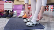 Stock Video Footage of Little girl choosing and trying on new  flat shoes in children shoe store
