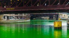 Closeup of Chicago River dyed green during St Patrick's Day 2013 - stock footage