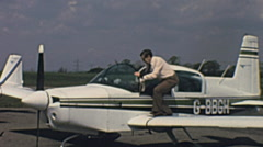 England 1970s: officer checking a Piper aircraft securtity Stock Footage