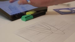 Graphs. Plotting. Using a tablet. Stock Footage