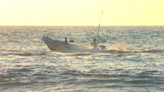 Powerboat tracking shot against the sunset, slow motion Stock Footage