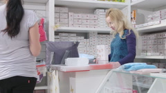 Husband with  pregnant wife buying pregnancy hospital bag  in baby shop Stock Footage