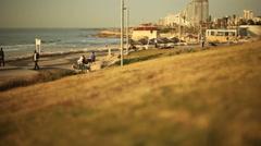 Tel-Aviv Jaffa beach boardwalk coastline sunset, long shot, shallow focus Stock Footage