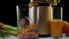Dolly:  extracting fresh juice from carrot apple celery using cold press juicer Stock Footage
