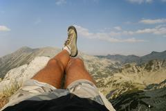 Male Legs Relaxing at the Summit Stock Photos