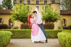 Romantic Fairy Tale Couple Dancing in Beautiful Palace Garden Stock Photos