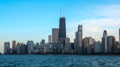 Sunset over Chicago, with Lake Michigan and landmark skyscrapers Stock Footage