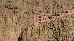 The house on the cliff of Gorges du Dades valley which is sedimentary rock wi Stock Photos