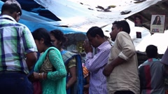 people praying before temple India - stock footage