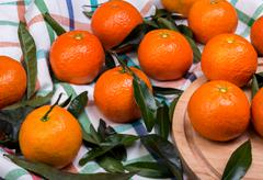 brunch of tangerines on a linen towel - stock photo