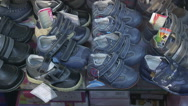 Stock Video Footage of Dolly: Shelf with shoes and sneakers for kids in the children shoe store