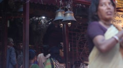 People praying and entering Shiva temple village India Stock Footage