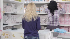 Shopping for pregnancy clothes in baby and maternity store Stock Footage