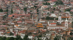 Stock Video Footage of Pan over historic center of colonial city of Cuenca in Ecuador