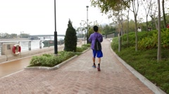 Young boy walking and play basketball tricks, throwing ball, spinning Stock Footage