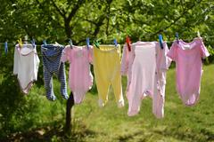 Baby clothes on the washing line Stock Photos
